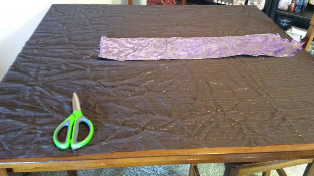 Yep, all that brown sparkly stuff is getting pleated down to just a little wider than the purple panel.